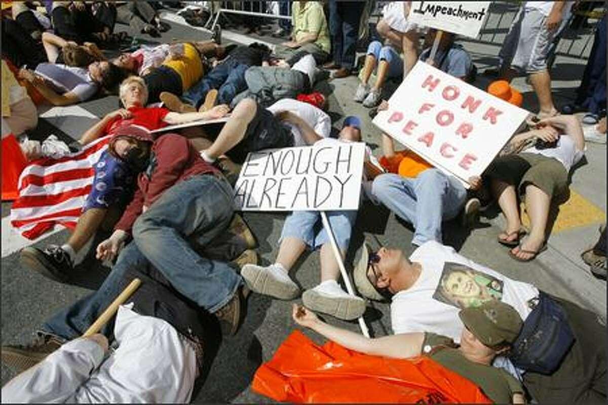 Protestors participate in a