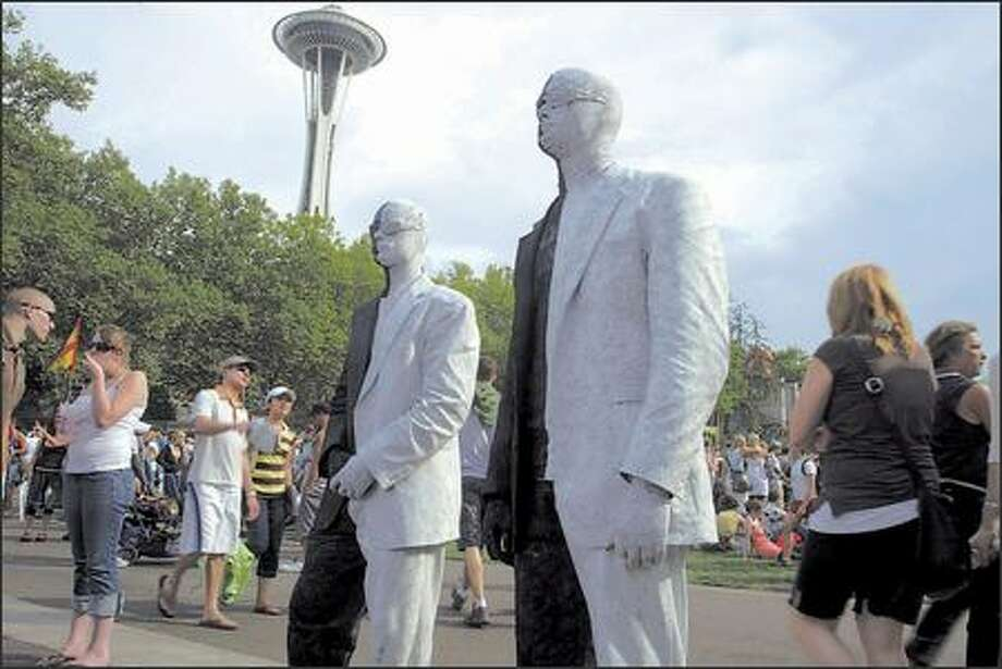 Two street performers entertain the crowd at Bumbershoot on Sunday September the Seattle Center. Photo: Gilbert W. Arias, Seattle Post-Intelligencer / Seattle Post-Intelligencer