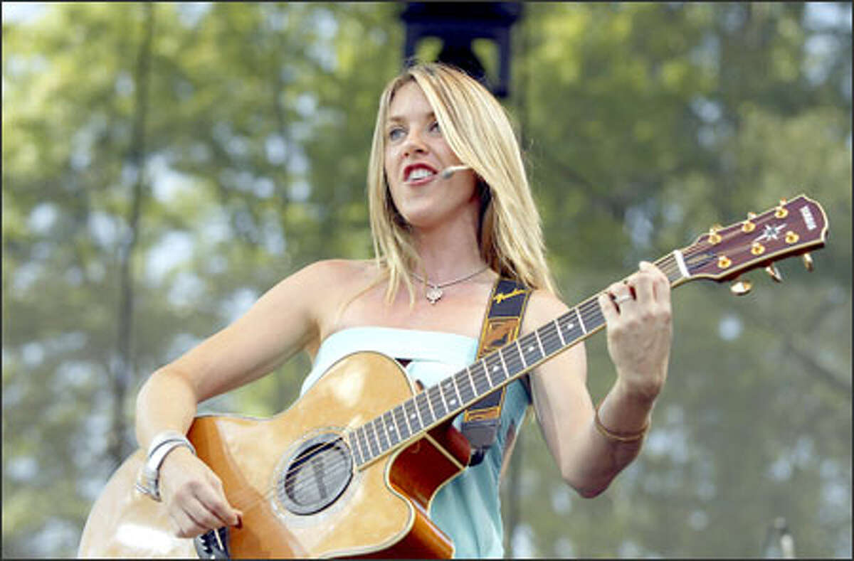 Liz Phair plays the Bumbershoot Mainstage Sunday afternoon. Phair played some older alternative favorites as well as more pop recent songs, but her set was marred by sound problems.
