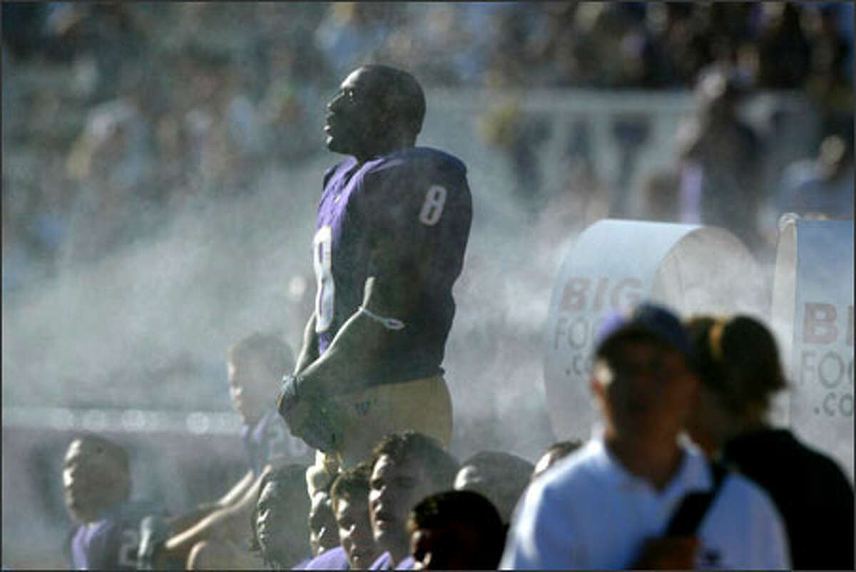University of Washington tailback Kenny James tries to keep cool in a swirl of mist as he waits to take the field in the second half of the Huskies' game against Fresno State. Washington lost 35-16.