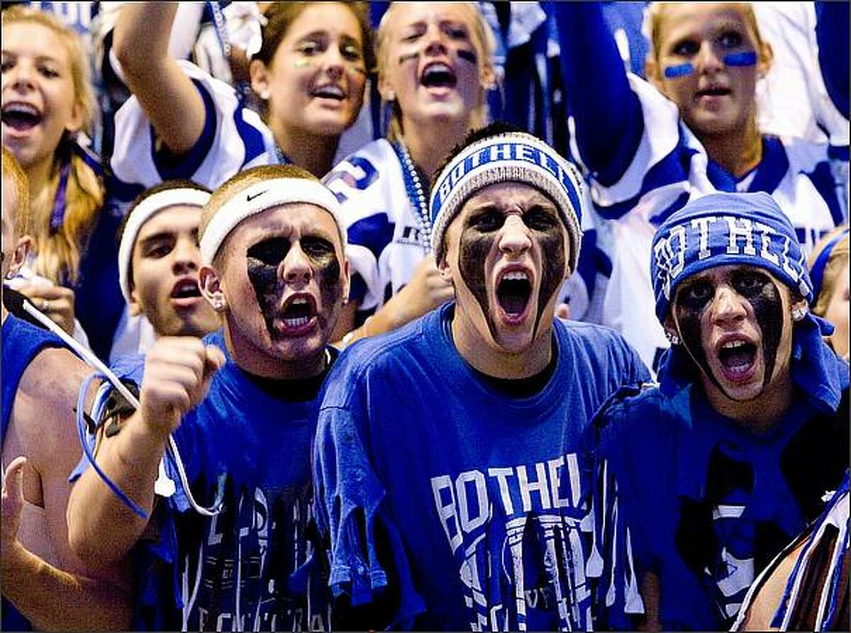 On the opening night of high school football season, Bothell fans cheer their team Thursday. Bothell's opponent, Issaquah, won the game 24-13. (Grant M. Haller/Seattle P-I)