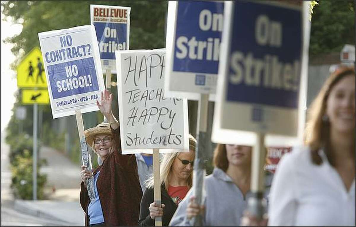Linda Casey, an art teacher at Odle Middle School in Bellevue and dozens of her colleagues picket on Tuesday, September 2, 2008. Casey has taught in the Bellevue School District for six years. (Paul Joseph Brown/Seattle P-I)