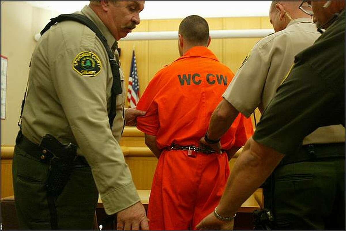 Isaac Zamora is escorted out of the courtroom at the conclusion of his arraignment at Skagit County Courthouse in Mount Vernon on Sept. 3, 2008.