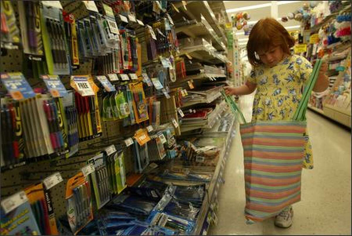 Hannah Leigh searches the aisles of a drugstore for school supplies on Sept. 1 in Seattle. She started kindergarten at Bryant Elementary this week after hre family spent months researching potential schools. Hannah's genetic code is scrambled just enough to pose serious developmental and physical problems.