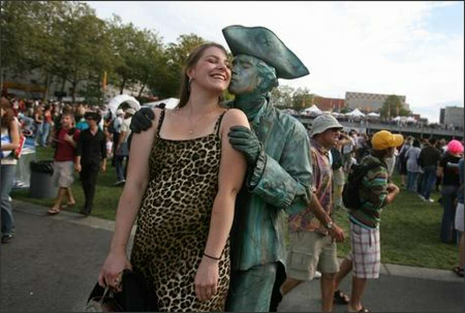 Monica Seward of Tacoma gets a kiss from Paul Revere (a.k.a. living statue Jesse Ferguson) at the 2007 version of Bumbershoot, Seattle's music and arts festival held at Seattle Center. Photo: Scott Eklund, Seattle Post-Intelligencer / Seattle Post-Intelligencer