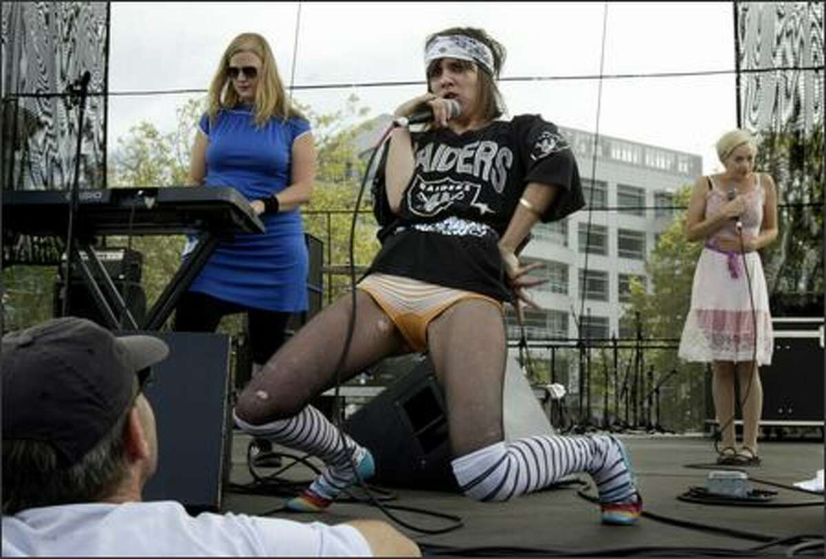 Kristin Allen-Zito, center, Lindy McIntyre, left, and Marissa Moore of The Trucks perform on the Sound Transit Stage at the Bumbershoot music and arts festival at Seattle Center.