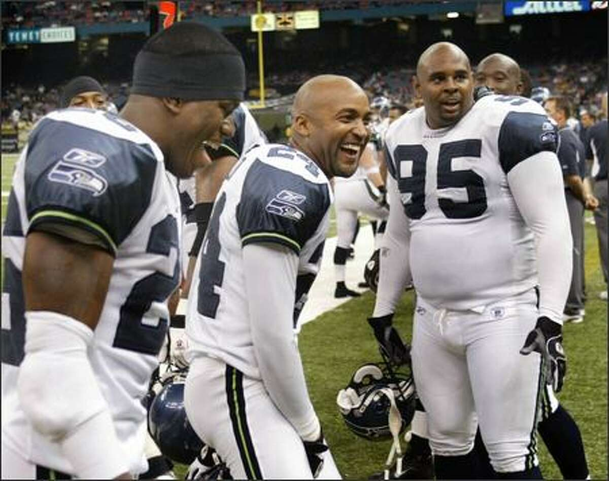 Seahawks' defenders, left to right, Ken Hamlin, Bobby Taylor and Rashad Moore had plenty to laugh and smile about as time wound down at the end of the game.