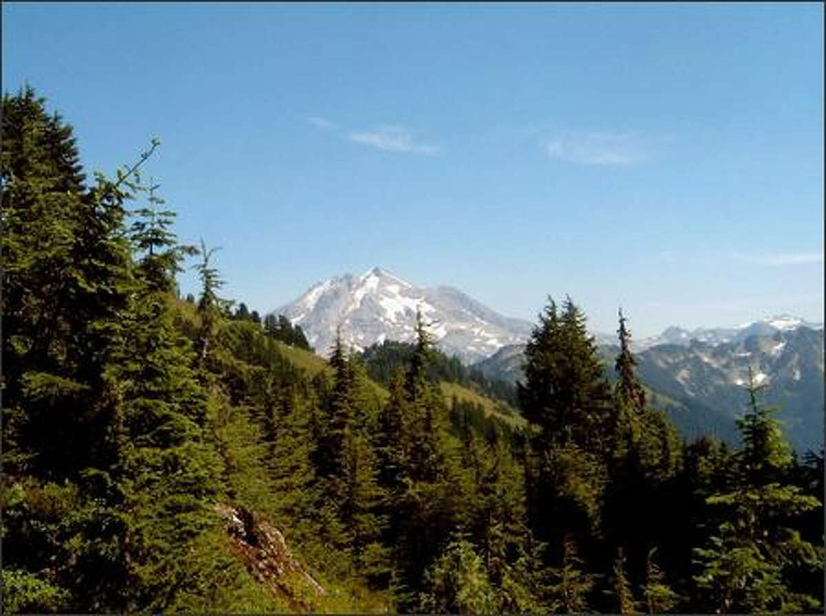 This view of Glacier Peak, a 10,520-foot volcano in the north-central Cascades, can be had after 5.5 miles and about 3,800 feet of elevation gain along the Lost Creek Ridge Trail.