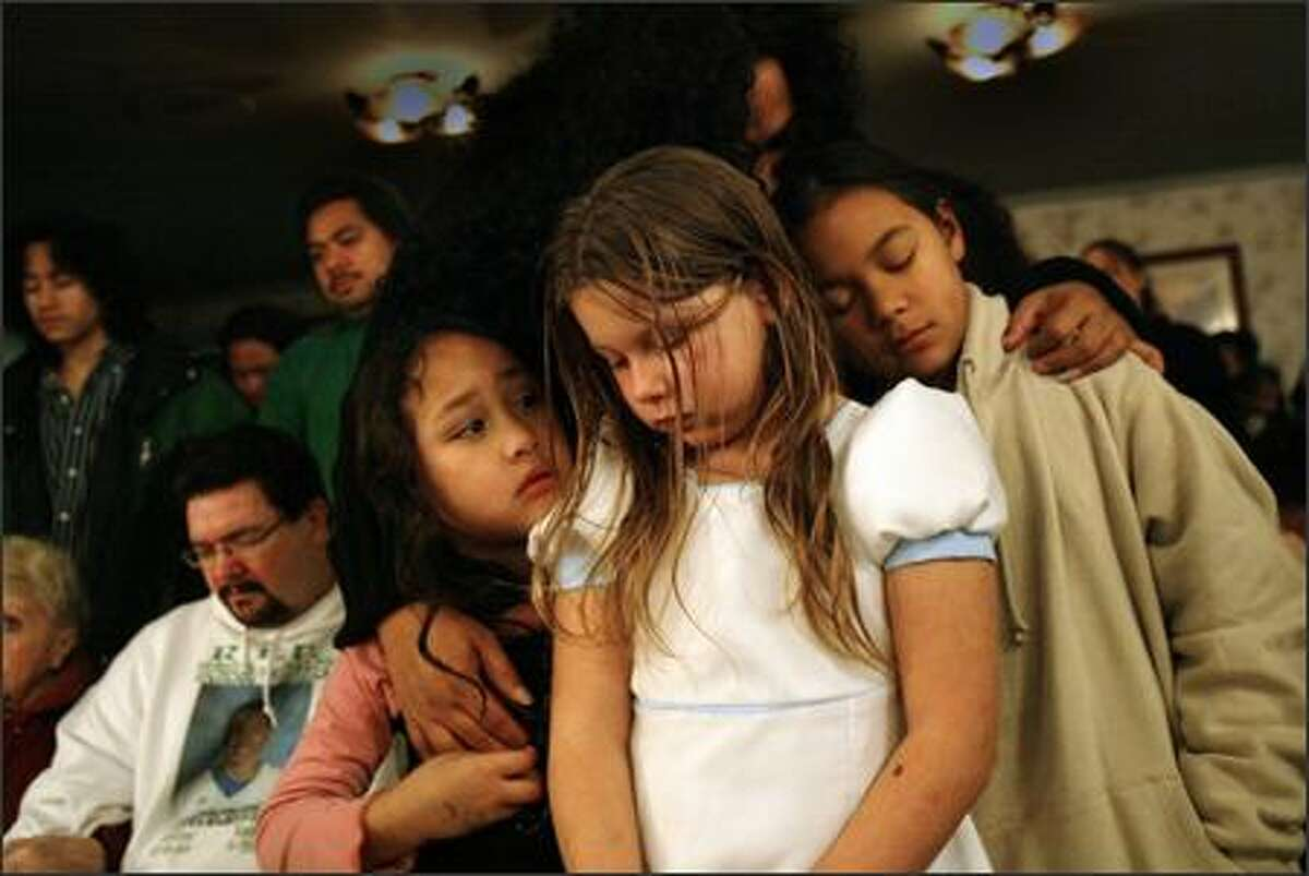 """""""I really miss him,"""" said Mataio Jantoc, age 10. """"Even though we're little, this has had one of the biggest impacts in our lives and it just really hurts."""" The Miller family participates in """"A Night of Remembrance"""" at the Greenwood Memorial Park and Funeral Home on December 10, 2006 in Renton."""