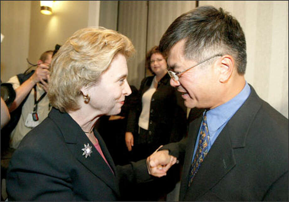Christine Gregoire is greeted by current Gov. Gary Locke after her acceptance speech at the Doubletree Hotel in Bellevue. Photo: Scott Eklund, Seattle Post-Intelligencer / Seattle Post-Intelligencer