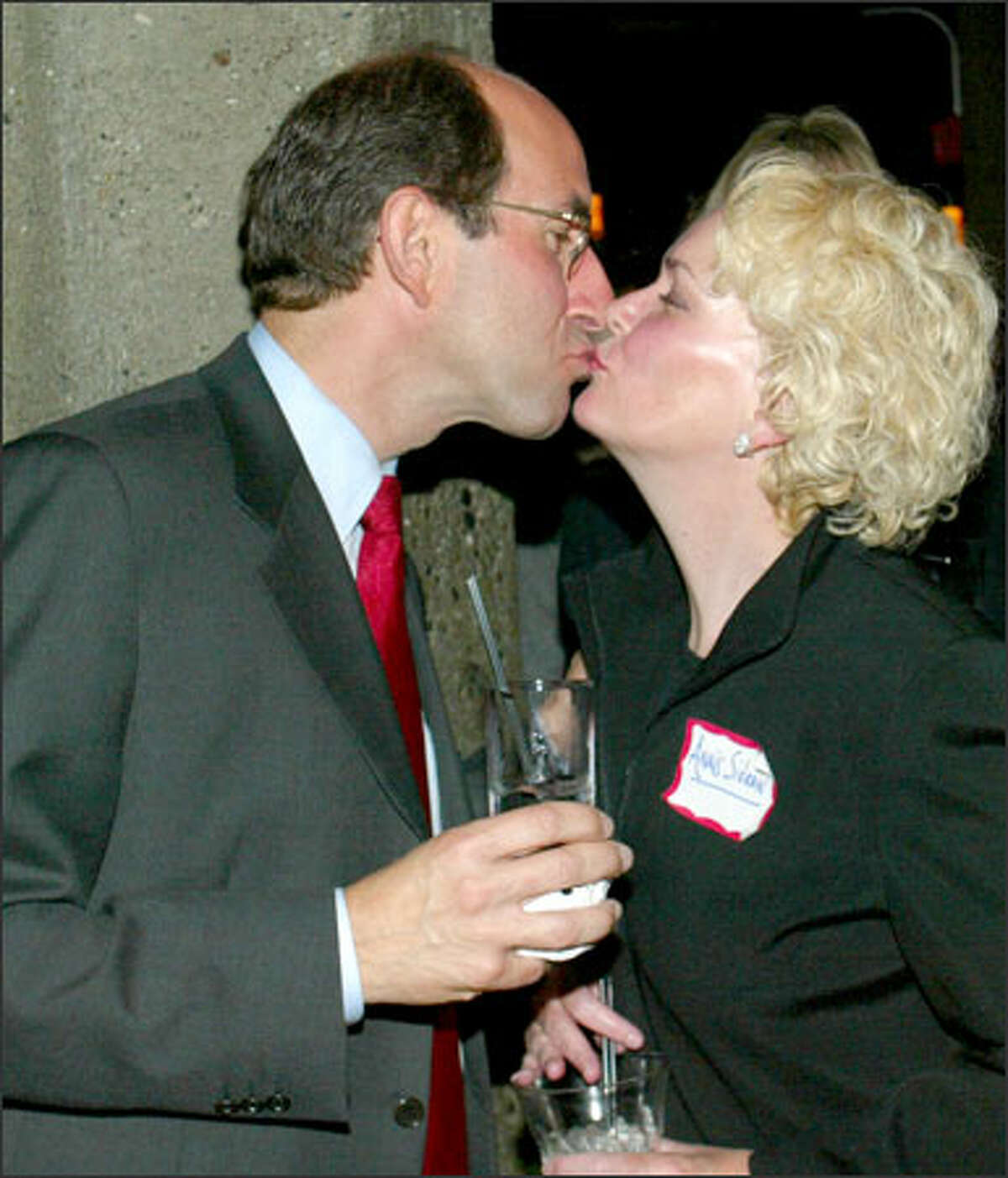 Mark Sidran kisses his wife, Anais Winant, at his campaign party at the Triple Door. Sidran remains hopeful that he'll come out ahead in the end.
