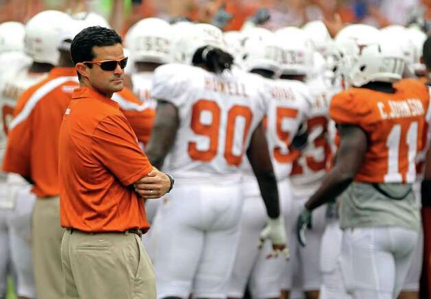 Two months ago, UT supporters worried about losing Manny Diaz (left) to Arkansas. Now, they'd just as soon see him jump on the back of Bobby Petrino's motorcycle and never come back. Photo: AP