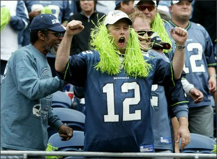 The 12th man is back in town as Jim Hemphill of Bremerton enthusiastically welcomes the Seattle Seahawks in the first home game of the season at Qwest Field. Photo: Scott Eklund, Seattle Post-Intelligencer / Seattle Post-Intelligencer
