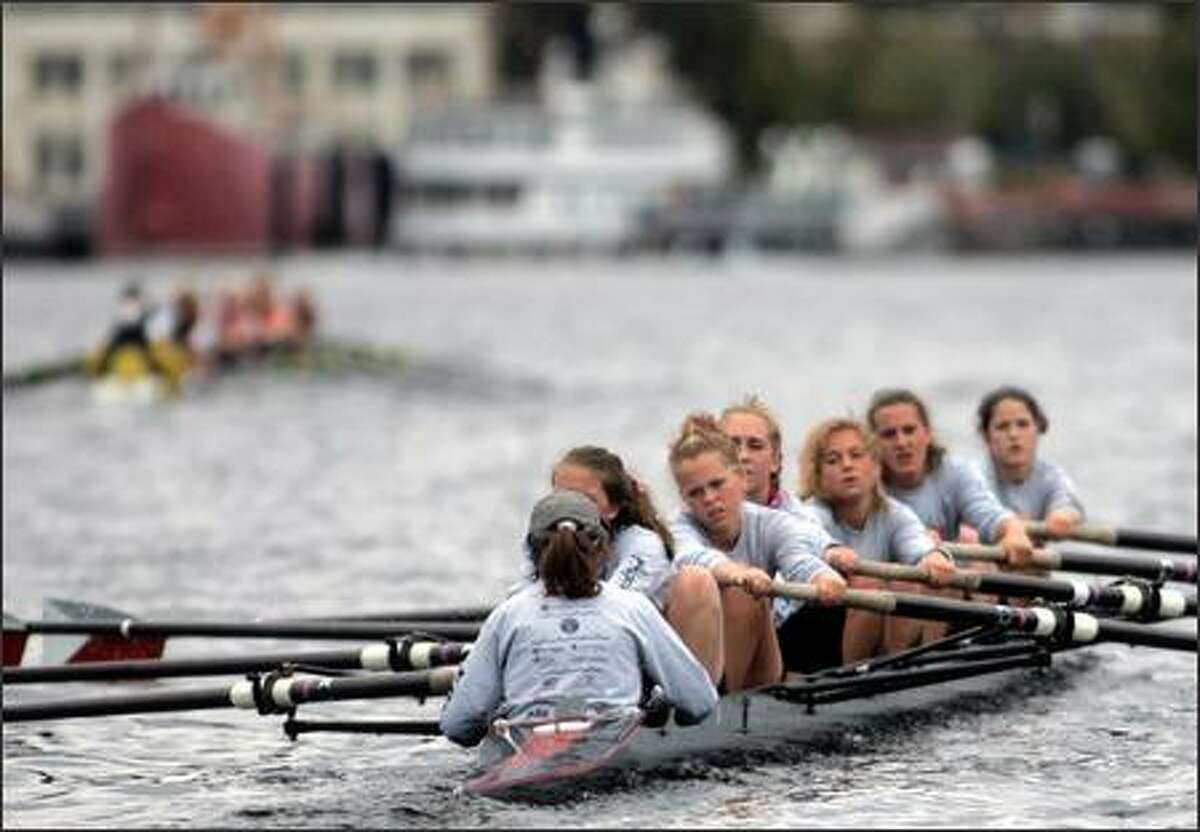 Rowers from Holy Names Academy in Seattle compete in Row for the Cure on Lake Washington. Sunday's event raised $40,000 for the Puget Sound affiliate of the Susan G. Komen Breast Cancer Foundation.