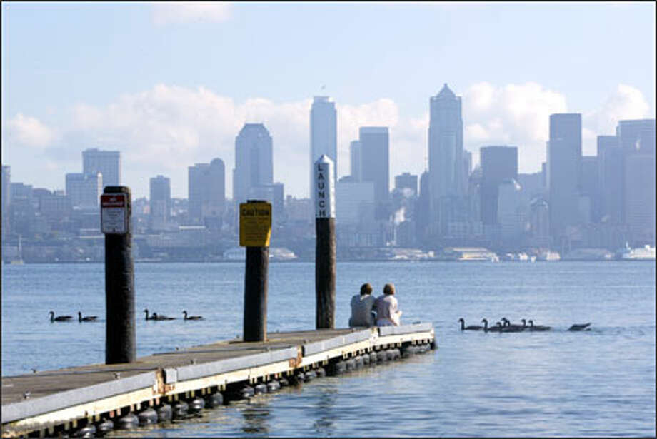Jake Johnson, left, and Alicia Minkel, both of Seattle, enjoy the weather, along with some solitude, on a boat ramp in West Seattle on the last full day of summer. Photo: Karen Ducey, Seattle Post-Intelligencer / Seattle Post-Intelligencer