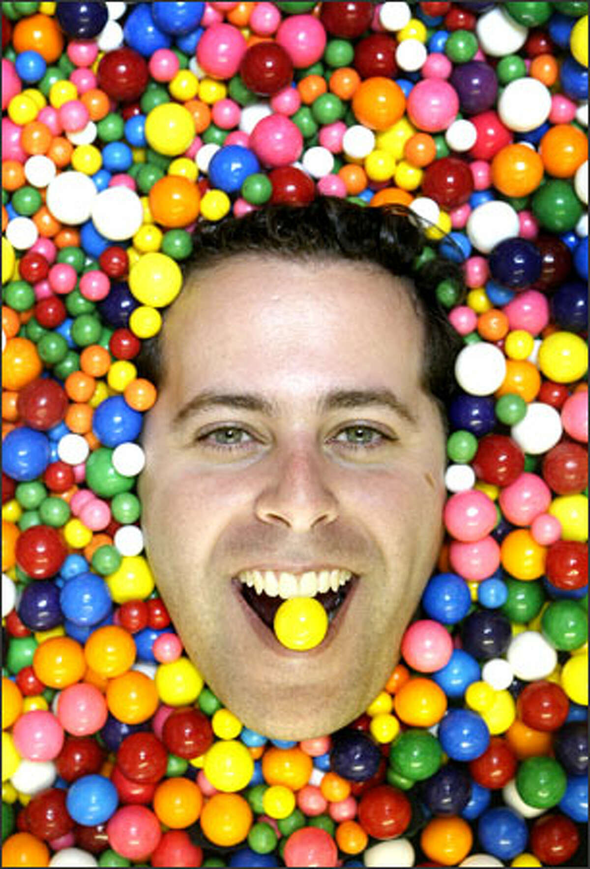 Tal Moore, founder of Gumballs.com, revels in the sweet confections dispensed by the machines that his company sells.
