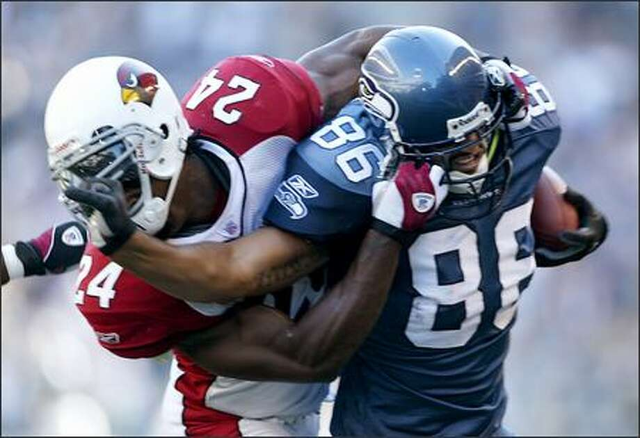 Seahawks tight end Jerramy Stevens tries to fight off Arizona safety Adrian Wilson as he get knocked out of bounds at the two yard line. Photo: Scott Eklund, Seattle Post-Intelligencer / Seattle Post-Intelligencer