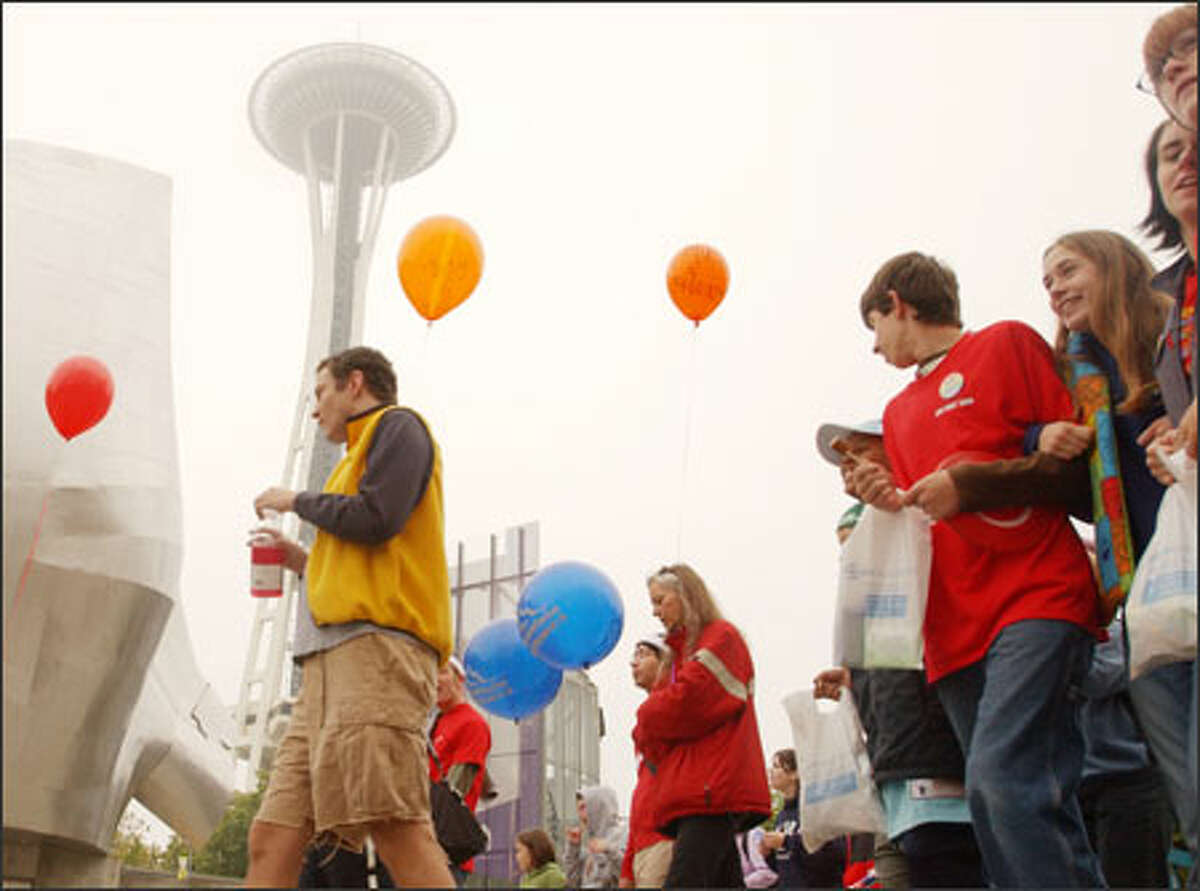 Despite fog, about 3,000 people turned out for the AIDS Walk yesterday. Here, they are seen heading into downtown from the Seattle Center.