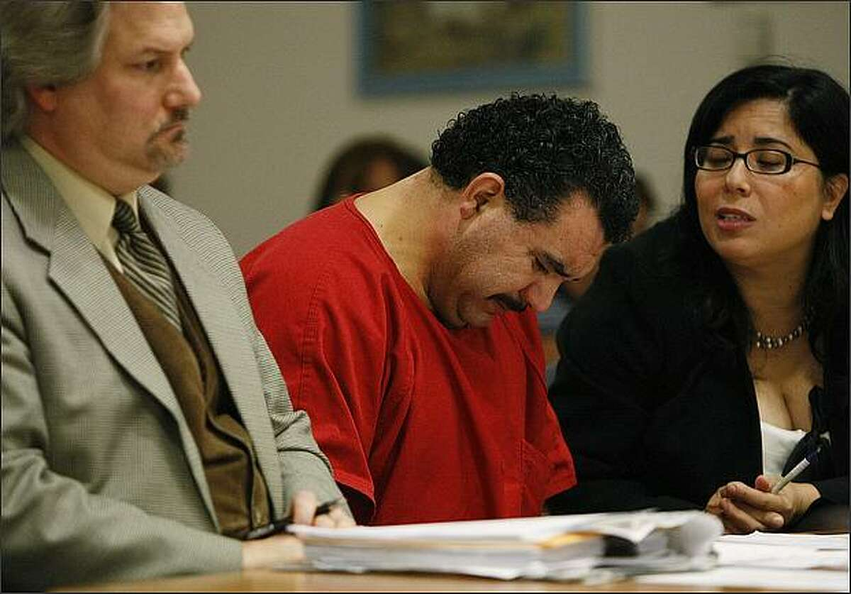 Alberto Rios, center, shows his emotion during his sentencing hearing at the King County Regional Justice Center on Friday, October 3, 2008, in Kent. Rios was convicted of manslaughter in the second degree and sentenced to 23 months in prison. (Brad Vest/Seattle Post-Intelligencer)