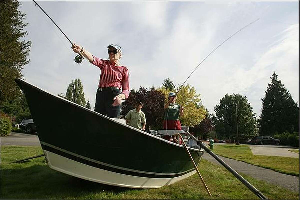 Margaret Simmons of Edmonds, front, and Lisa Coyne of Seattle, learn to fly fish as part of the program,