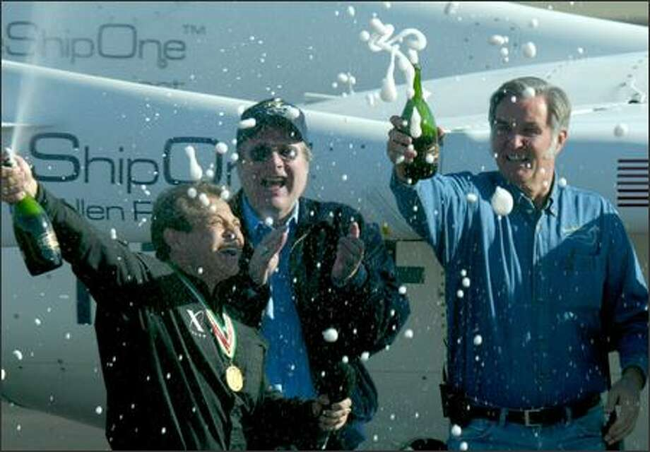 From left, X Prize Foundation Chairman Peter Diamandis, Paul Allen and Burt Rutan celebrate in Mohave, Calif., after the win yesterday. Photo: Grant M. Haller, Seattle Post-Intelligencer / Seattle Post-Intelligencer