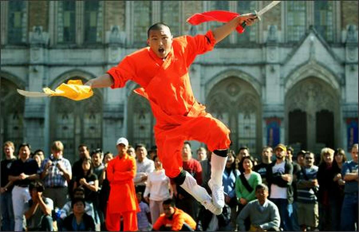 Wang Yudeng, 19, leaps during a performance of the Shaolin Kung Fu Spectacular at the University of Washington's Red Square on Thursday. Shaolin Temple in central China is the birthplace of one of the most famous schools of martial arts.