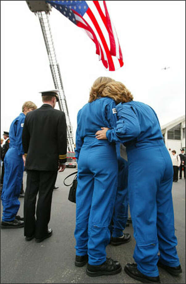 Northwest Airlift workers were among those who gathered Thursday at Boeing Field to honor three colleagues who died in a helicopter crash last week after dropping off a patient at Harborview. Photo: Paul Joseph Brown, Seattle Post-Intelligencer / Seattle Post-Intelligencer