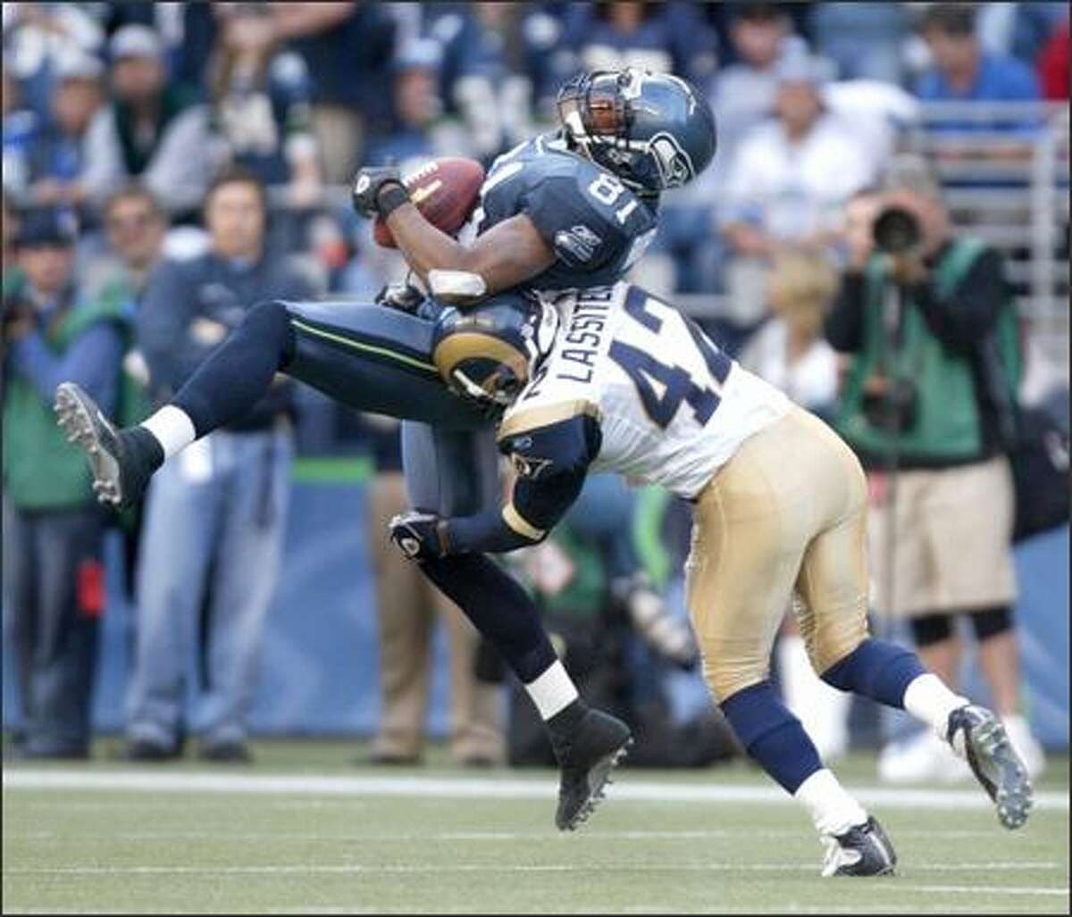 Seahawks wide receiver Koren Robinson actually held onto this ball after getting drilled by Ram' safety Kwamie Lassiter in the fourth quarter after a 10-yard gain and a first down.