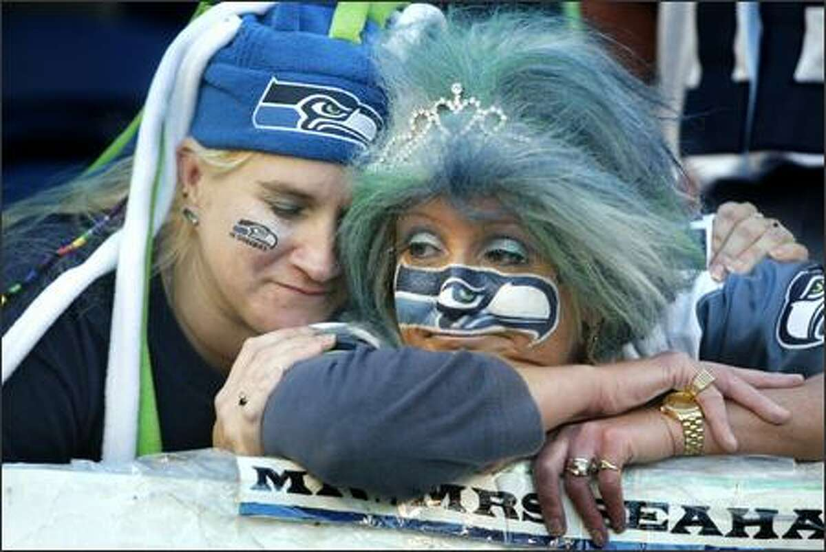 Seahawks fans Ronda Metzger, of Renton, left, and DeDe Schumaier, of Auburn, lament their team's sudden overtime loss to the Rams.