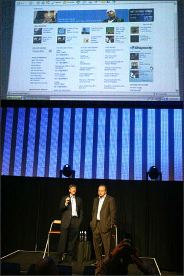Together on stage at the Experience Music Project, longtime digital-media rivals Bill Gates, left, and RealNetworks' Rob Glaser pledged to work together on gaming and online music. Photo: Scott Eklund, Seattle Post-Intelligencer / Seattle Post-Intelligencer