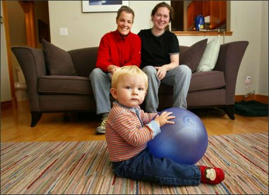 """Sheri Hendricks, left, and her partner, Kimberly Brandom, moved into a Fremont condo with """"having a baby in mind,"""" Brandom says. They believe their son, Cole Hendricks, will be exposed to more lifestyles. Photo: Jim Bryant, Seattle Post-Intelligencer / Seattle Post-Intelligencer"""