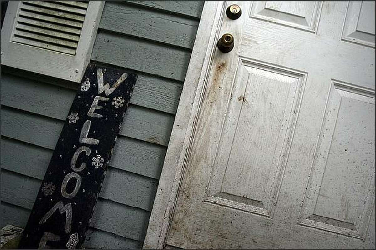 The front door at 31218 NE 114 Ct. - the scene of a child abuse case where the parents starved their children according to the King County Sheriff's office, in Carnation, Wash.