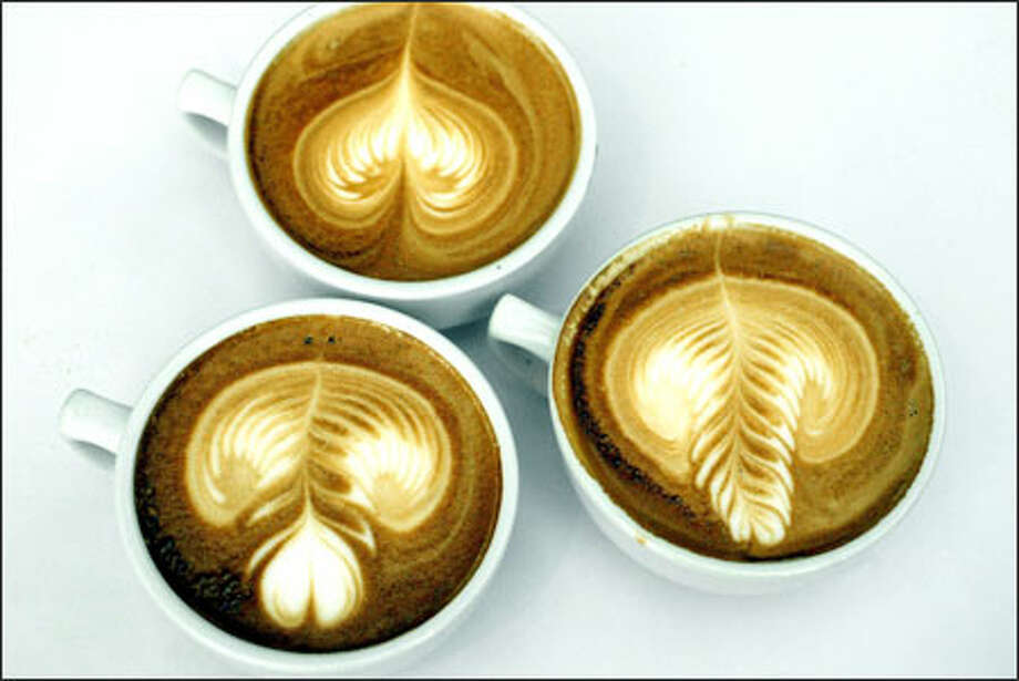 Three lattes show the artistry of JC Morris, from Caffe Artigiano in Vancouver, B.C., who won the Latte Art competition at the Coffee Fest Trade Show in Seattle.  Judges rated competitors for definition, color diffusion and creativity.  Morris was the defending champion from last year. Photo: Meryl Schenker, Seattle Post-Intelligencer / Seattle Post-Intelligencer