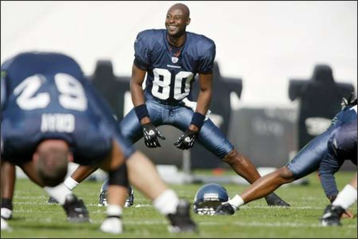 Seahawks' Jerry Rice stretches with his new team during practice in Kirkland. Rice, 42, the NFL career leader in receptions (1,524), receiving yards (22,533) and receiving touchdowns (194), joined the Seahawks on Tuesday from the Oakland Raiders. (Seattle Post-Intelligencer, Joshua Trujillo)