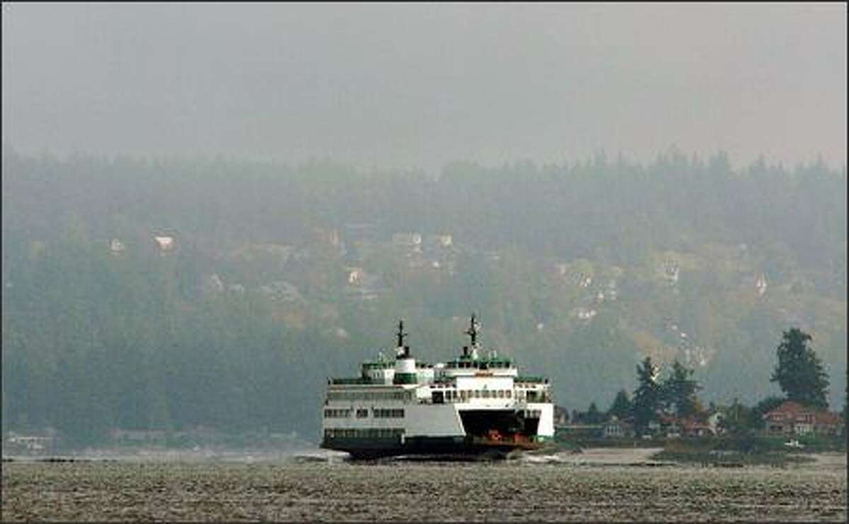 The Washington State Ferry Kitsap pulls into the busy Bremerton dock.