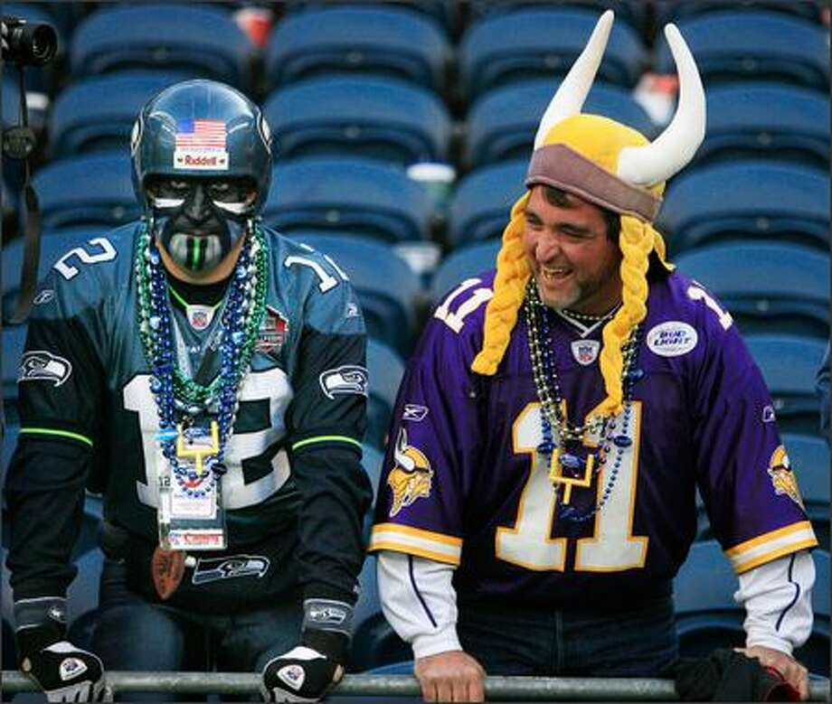 "Seahawks fan Brad ""Cannonball"" Carter of Sumner glowers after the game, while Everett's Mark Gifford yuks it up after his Vikings' 31-3 victory Sunday. Photo: Dan DeLong, Seattle Post-Intelligencer / Seattle Post-Intelligencer"