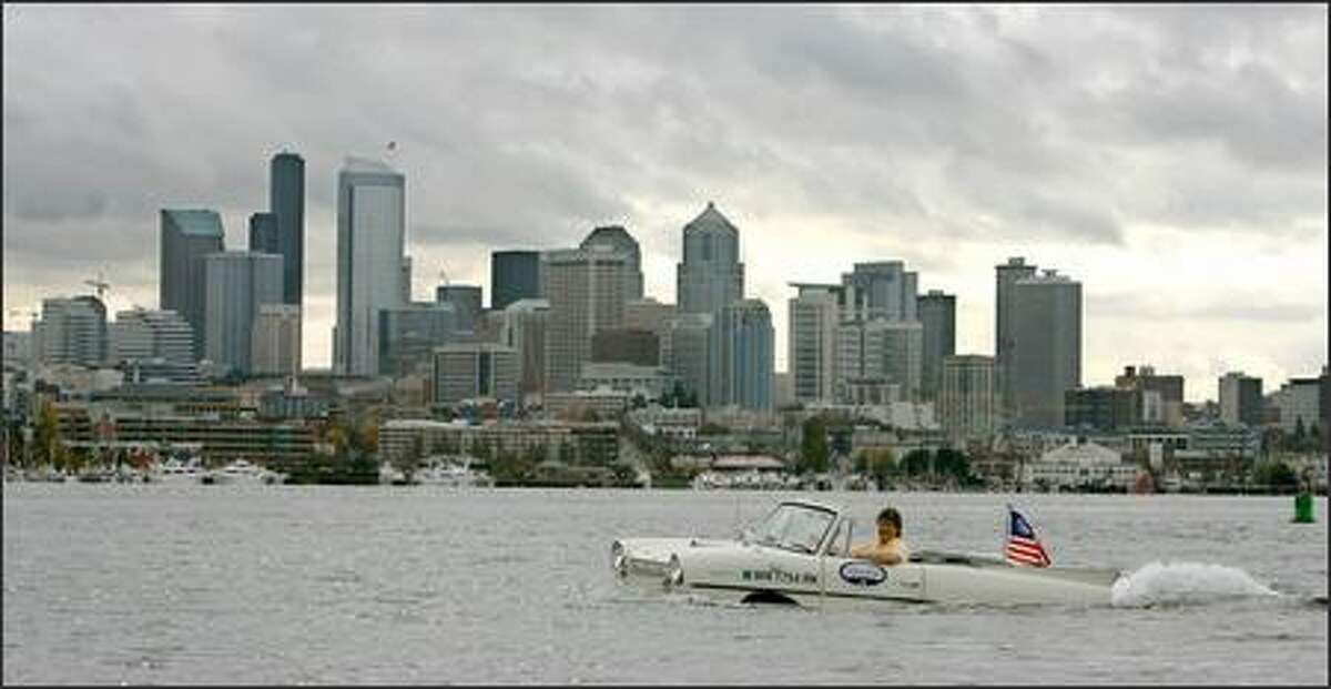Rick Seim drives his 1965 Amphicar into Seattle from Kirkland's Marina Park on the eve of the Seattle Auto Show. According to amphicar.com, just 3,878 of the vehicles were built in Germany from 1961 to '68. New models sold for between $2,800 and $3,300, and had a top land speed of 70 mph and water speed of 7 mph. Seim will display his restored Amphicar for five days at this year's show at Qwest Field Event Center.