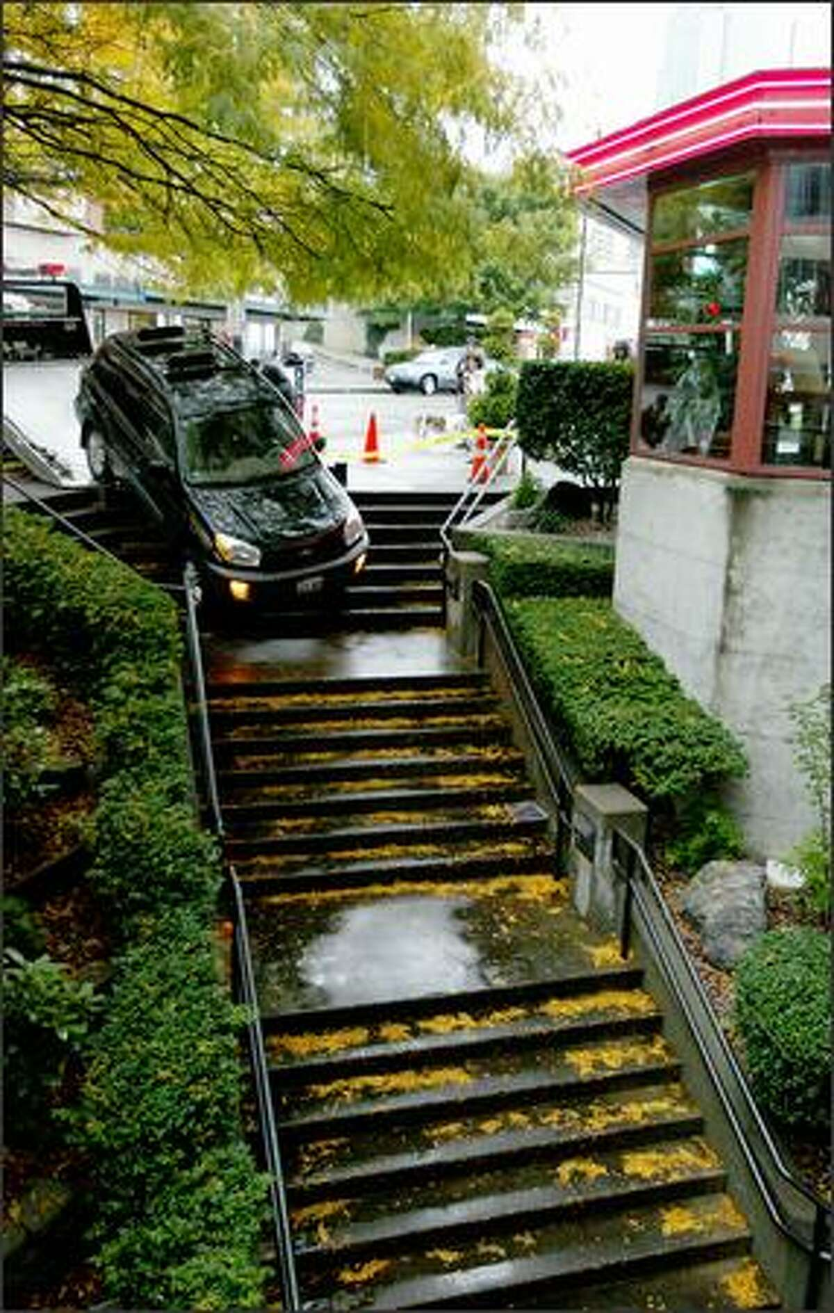 On Tuesday, a woman drove down the first flight of stairs underneath Cutters Restaurant on Western Avenue, just north of Pike Place Market. She thought she was turning into a parking garage.