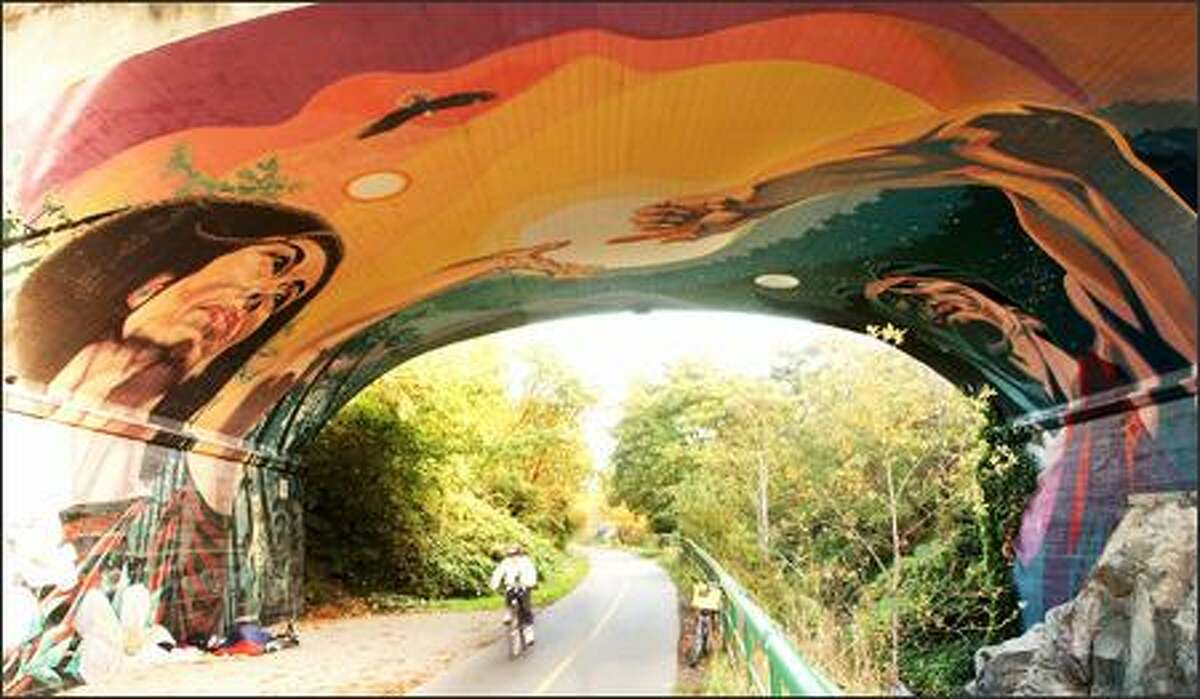 One of the largest murals in Victoria covers the 3,000-square-foot underside of this concrete bridge along the Galloping Goose Regional Trail north of the Selkirk Trestle.