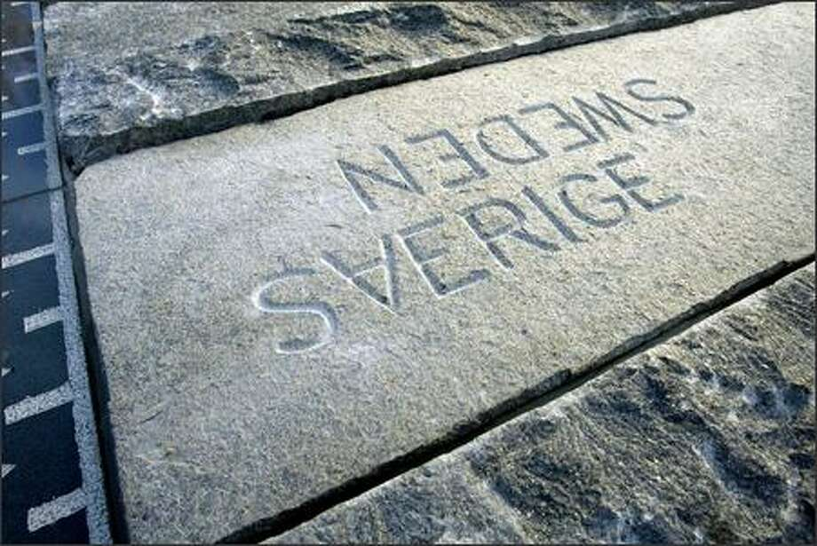 """One of the newly installed granite slabs at Ballard's Bergen Place Park has the Swedish word for Sweden misspelled. The word should be """"Sverige."""" The mistake can be repaired, according to a bricklayer trainer. Photo: Paul Joseph Brown, Seattle Post-Intelligencer / Seattle Post-Intelligencer"""