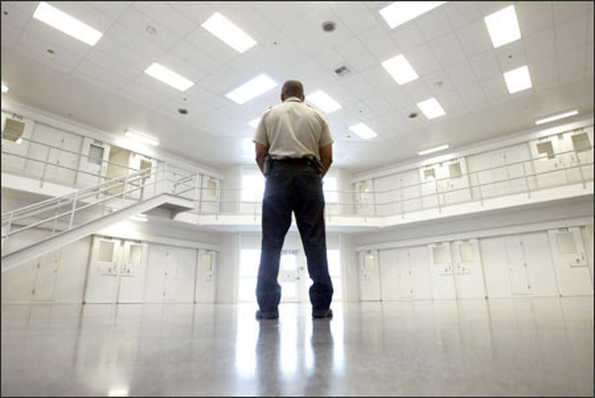 An officer stands guard recently in the solitary-confinement area of the new Northwest Detention Center, an immigration holding facility in Tacoma. The center can hold up to 760 inmates.