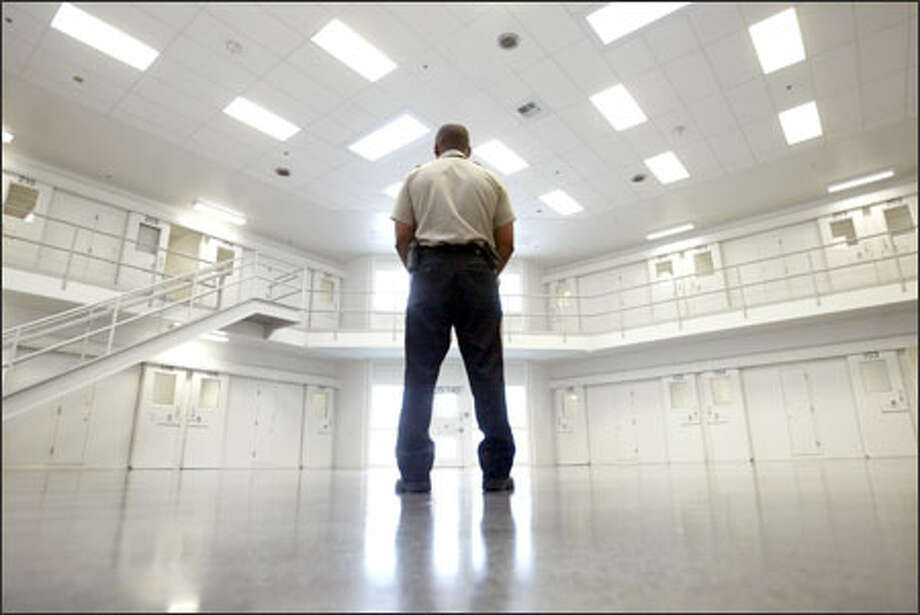 An officer stands guard recently in the solitary-confinement area of the new Northwest Detention Center, an immigration holding facility in Tacoma. The center can hold up to 760 inmates. Photo: Scott Eklund, Seattle Post-Intelligencer / Seattle Post-Intelligencer