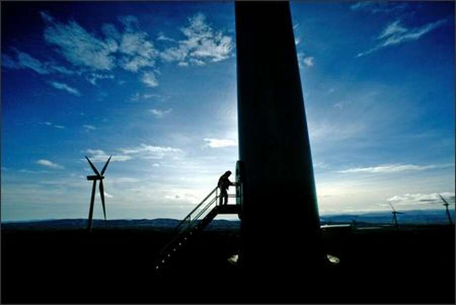 Puget Sound Energy worker Tom Bensel enters a wind turbine at the Wild Horse Wind Project to check the operations computer inside the tower. The project is expected to serve about 70,000 customers. Photo: Grant M. Haller, Seattle Post-Intelligencer / Seattle Post-Intelligencer