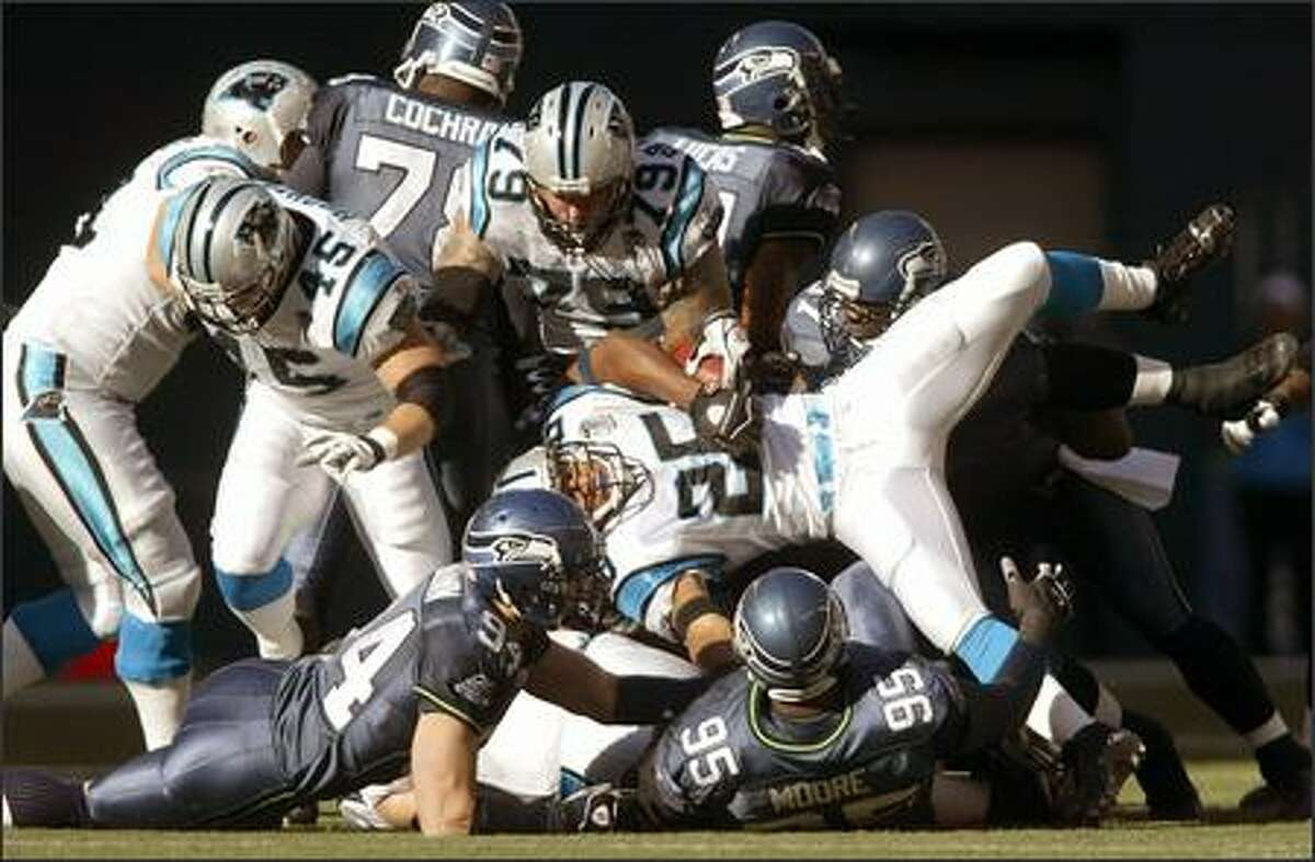 Seattle Seahawks defense turns Carolina Panthers Joey Harris on sideways in the first quarter.