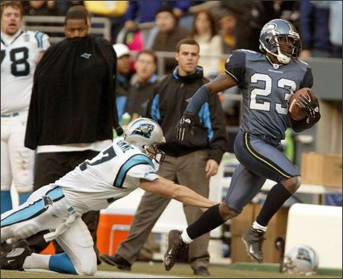 Seahawks cornerback Marcus Trufant runs his interception past Carolina Panthers quarterback Jake Delhomme in the fourth quarter.