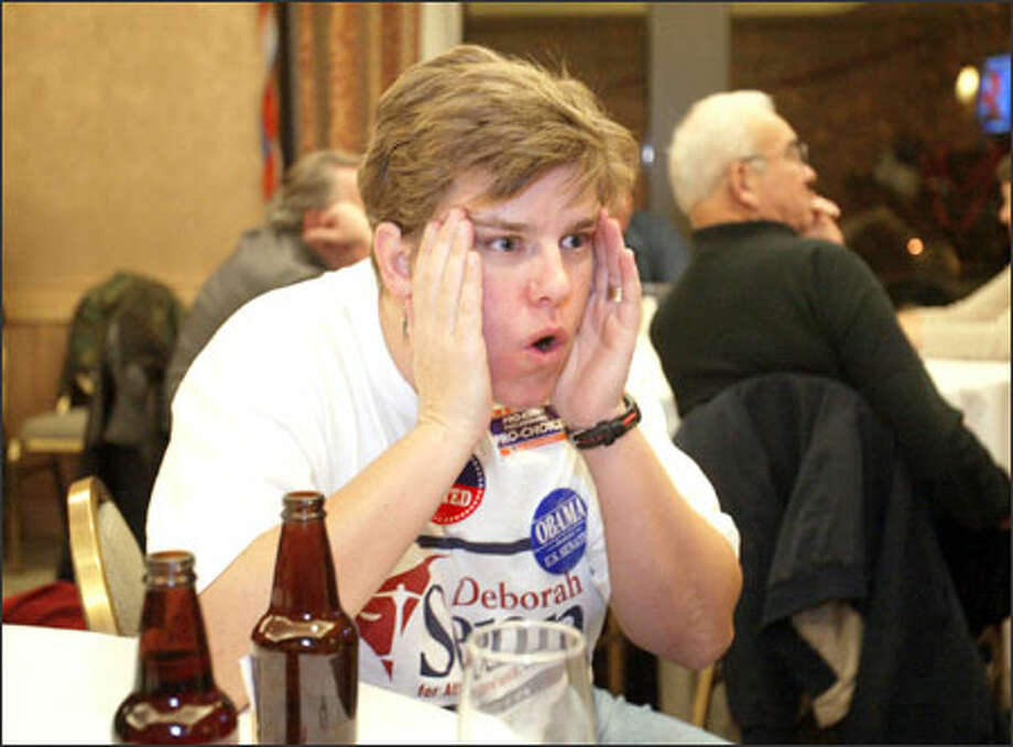 Dawn Sydney, who works for Deborah Senn's campaign for attorney general, displays disbelief as she watches NBC News project President Bush as the winner in the critical battleground state of Ohio. Photo: Scott Eklund, Seattle Post-Intelligencer / Seattle Post-Intelligencer