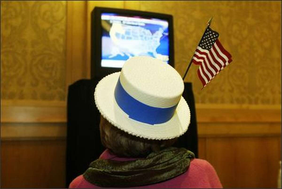 Stephanie Doran of Kirkland watches national results at the Democratic election night party at the Westin Hotel.