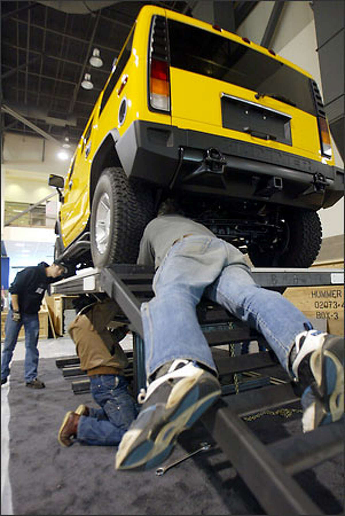 The Hummer H2 is just one of the new 2004 models that will be on display during the Seattle International Auto Show, which began Wednesday, Nov. 12. Hummer does not provide specific gas mileage for the H2, shown on a display mount, but its previous version got about eight to 14 miles per gallon. The 2004 model costs $57,650.