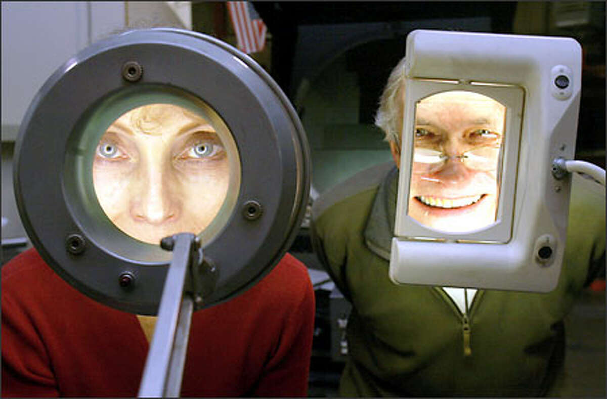 """""""Everything we do now, we do under a magnifying glass,"""" says Form Factor's Elaine King, left, shown with her husband, Chuck Budnik, at their metal-fabricating operation in Fremont. The company specializes in intricately formed miniature metal parts for a variety of industries."""