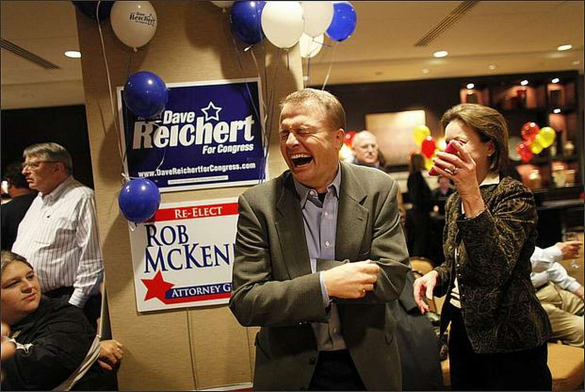Tim Eyman shares a laugh with friend Susan Sigl during a gathering of Republicans at the Hyatt hotel in Bellevue.